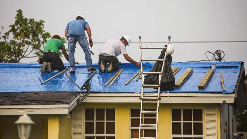 Contractors Fixing A Roof